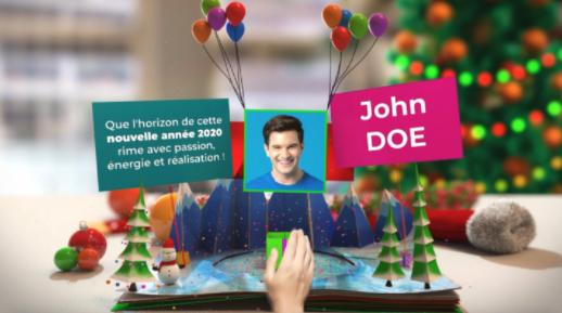 Une carte de video en vidéo souhaite la bonne année à John Doe, son nom apparait dans la vidéo personnalisée